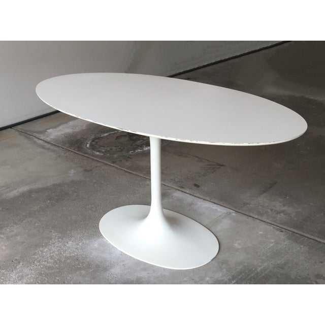 Mid century oval tulip table in the style of Eero Saarinen for Knoll. May be used as a dining table or as focal point in...