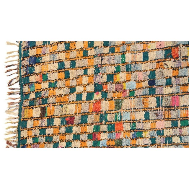 "The New York Times on Boucherouite rugs, also called ""rag rugs""; ""They seem more suitable for framing than trampling..."