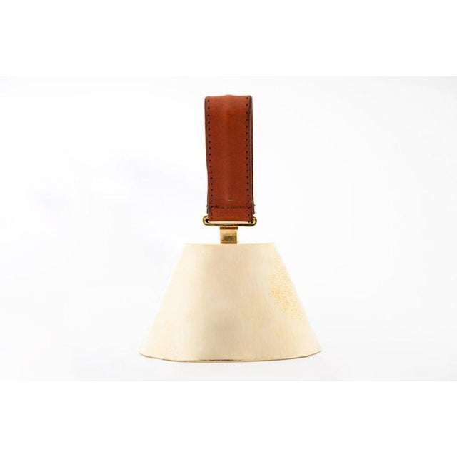 Carl Aubock Model #3603L large brass and leather bell. Designed in the 1950s, this incredibly refined and sculptural bell...
