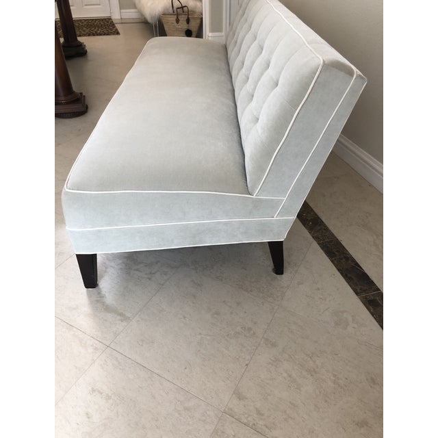 Pale gray velvet armless sofa with creamy ivory/ off-white contrasting piping. Espresso/black legs. Biscuit tufted top,...