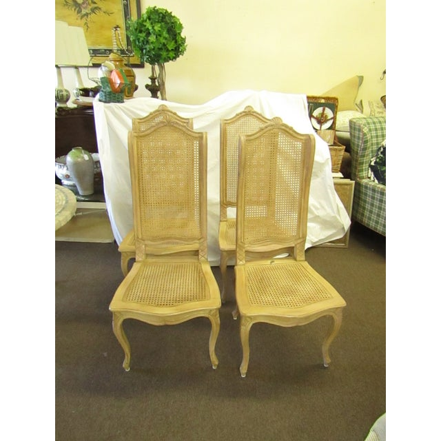 Baker Furniture Company Dining Chairs with Cane Seats and Backs. The backs are tall with a crown top giving them elegance...