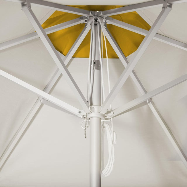 The Lemon Frappe Market Umbrella is a 9' Hexagon in Aluminum. The umbrella's main canopy is fabricated in Whipped Cream,...