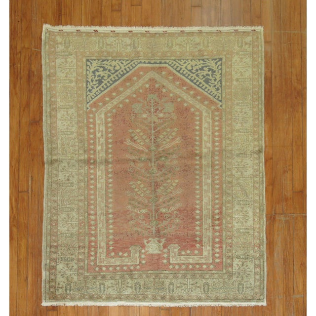 One-of-a-kind antique turkish rug woven in central anatolian village with a casual prayer niche motif. Circa 1920.