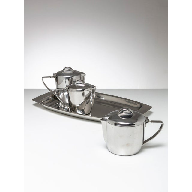 Set composed by tray and three pitchers by Gio Ponti for Calderoni, Milano Size of the biggest pitcher is cms 18 x 1 2 x 12.