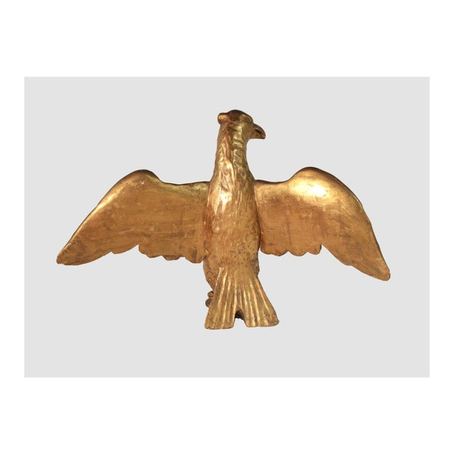 Beautiful and authentic gilt carved wood Eagle from the 19th century. 20 by 24 inches