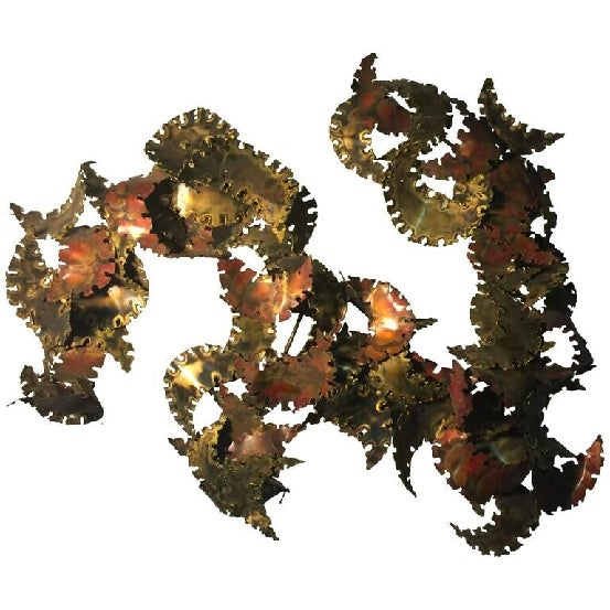 An amazing torch cut wall-mounted abstract sculpture by Silas Seandel, circa 1970. Great design and patina.
