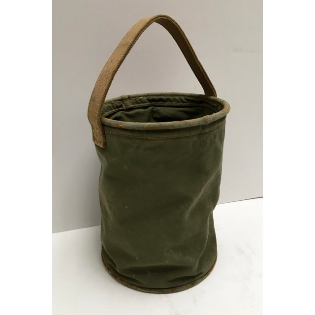 Own a piece of history. This bucket was used during the war when metal was needed for war materials. Canvas buckets were...
