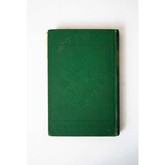 Gorgeous antique book with a striking emerald green cover.