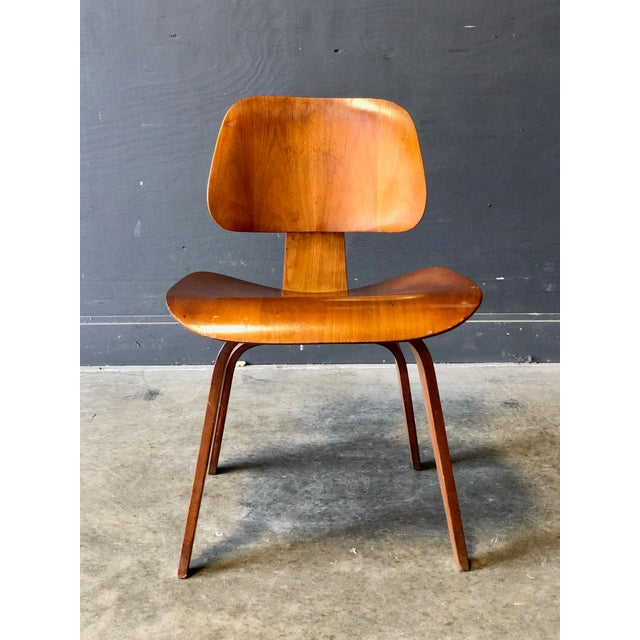 A Charles Eames for Herman Miller occasional chair. Timelessg design, excellent craftsmanship with bentwood throughout.