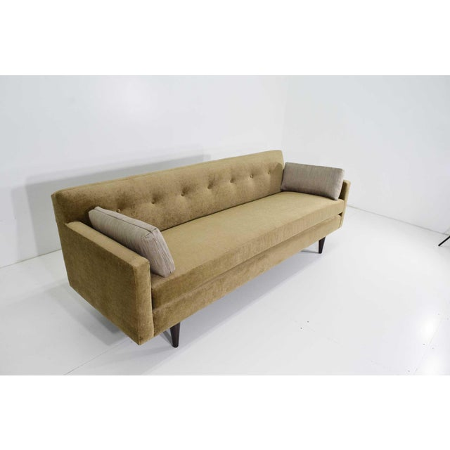 Dunbar sofa newly upholstered in Holly Hunt Cattail 100% linen with accent pillows in Holly Hunt Smokey Quartz.