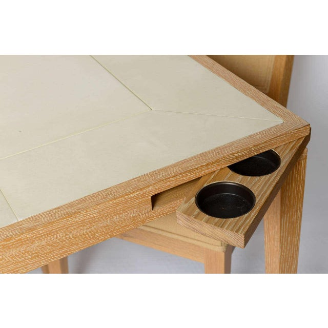 Originally sold through Holly Hunt, this lined oak and paper parchment top game table has swing out cup holders. Chairs...