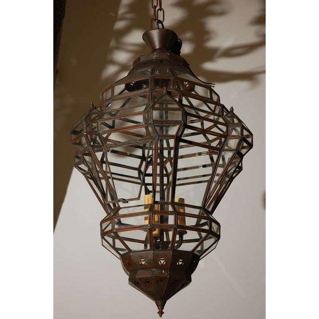 Elegant Moroccan Moorish diamond shape clear glass pendant with bronze metal finish, has a small window to access the...