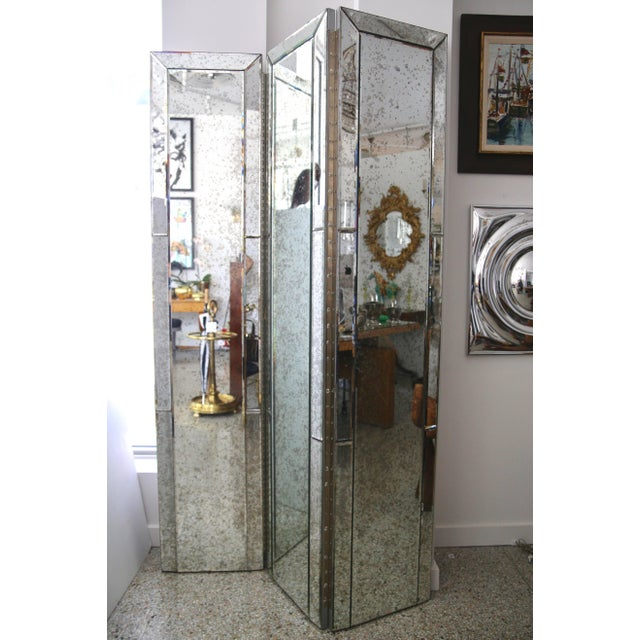 This stylish three-panel mirror will make the perfect divider or backdrop for your home with its antiqued mirror panels...