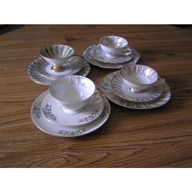 This is a set of 4 (plate, saucer, cup) from the mid century, made of porcelain/china in Bavaria/Germany. Each set is...