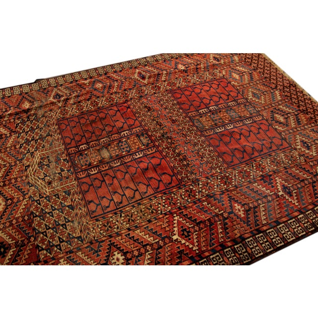 Early 20th Century Antique Turkaman with an all over red geometric motif. This piece has fine details, great colors, and a...