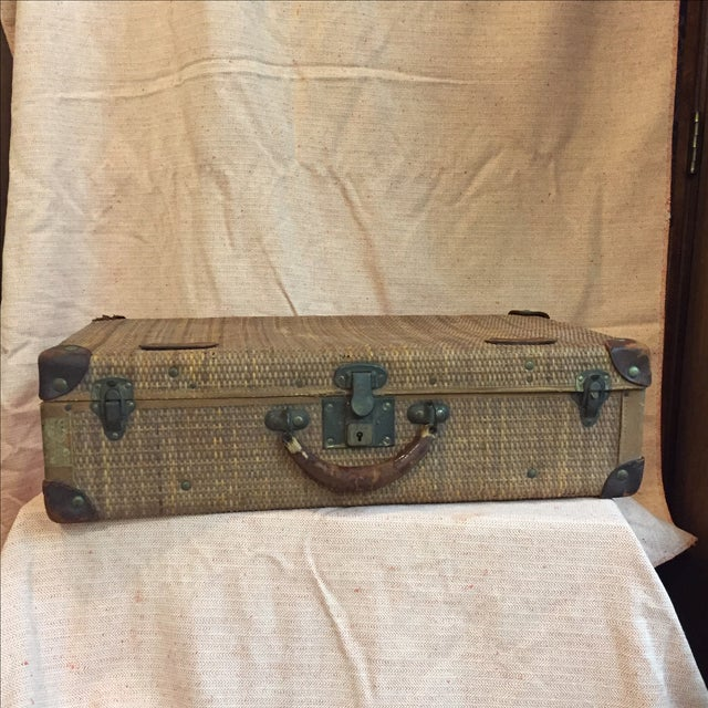 """Vintage woven rattan suitcase with leather trim and metal hardware. Original fabric interior. Stamped """"M.H.W."""" on the..."""