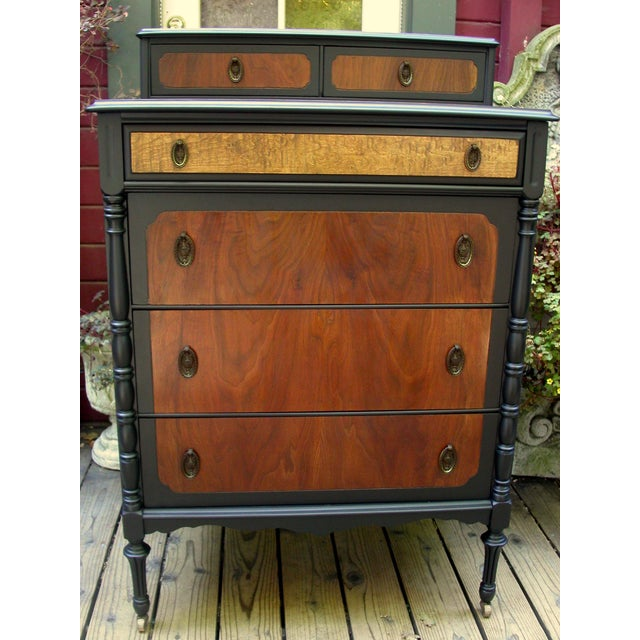 This early 20th century high boy dresser has been professionally restored in a luxurious blending of walnut and a...