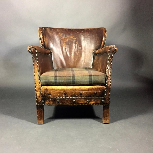 It doesn't get any better in terms of gorgeously worn leather patina than this diminutive club chair by Oskar Hansen, made...