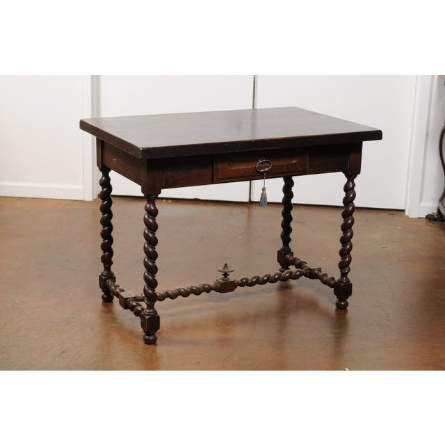 A French Louis XIII style walnut desk from the 19th century, with barley twist base. Born in France during the 19th...