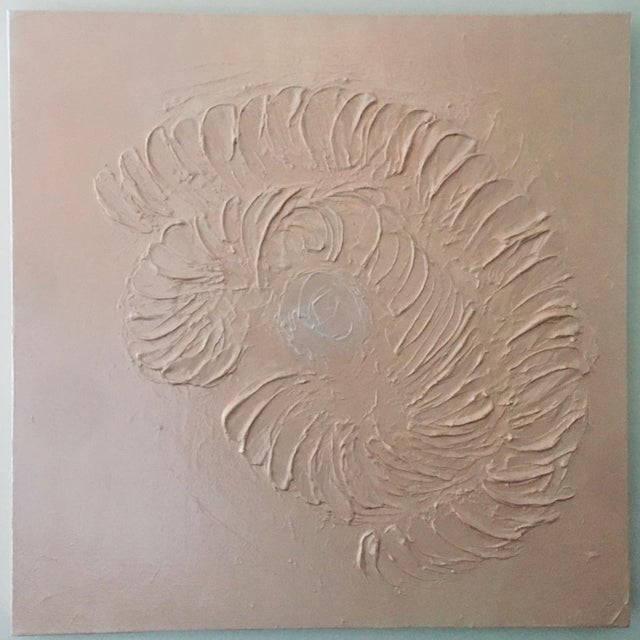 This 30 x 30 canvas features a molded surface to resemble an abstract nautilus shell. It is painted in blush acrylic and...