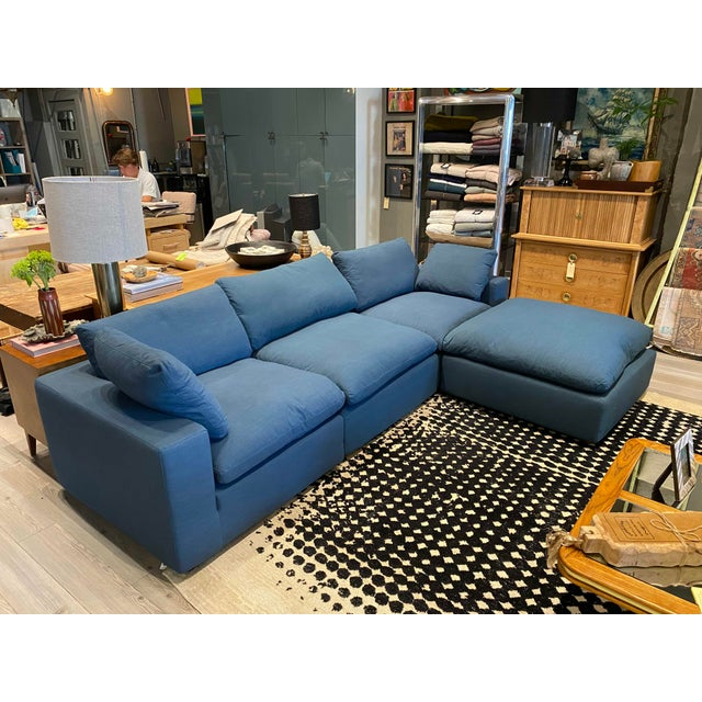 Overstuffed, low back, blue linen L shaped sofa. Great contemporary design! Perfect for a pop of color in your living room!