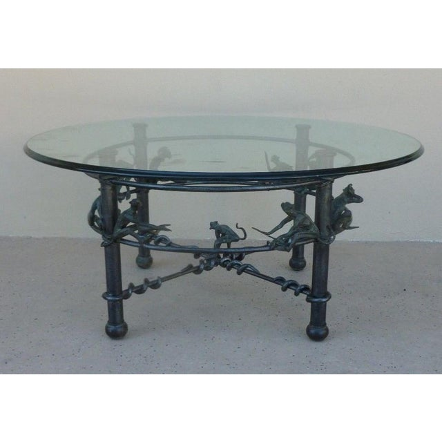 Vintage whimsical wrought iron coffee or occasional table with monkeys sold as found in vintage condition with no damage...