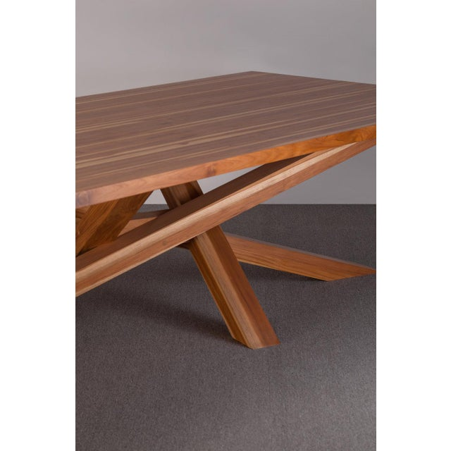 Made from strong Teak wood, this table was designed to create a warm, organic feeling from its fully natural build and it...