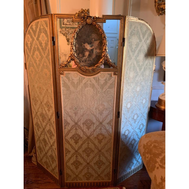 Fit for a princess French screen with an applied oval mezzotint engraved cartouche in a laurel leaf carved surround...