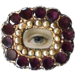 Early 19th Century Lover's Eye Georgian Garnet and Seed Pearl Brooch For Sale