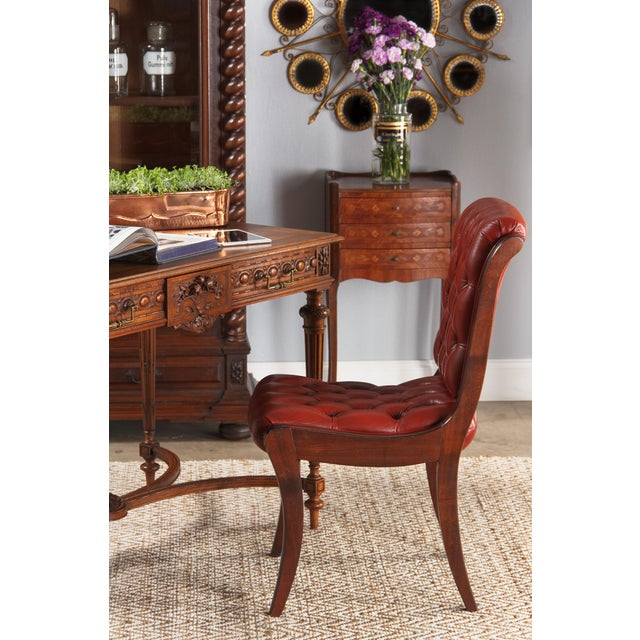 A beguiling little Louis XV style beside table in cherry wood and rosewood veneers with elaborate fruitwood marquetry. The...