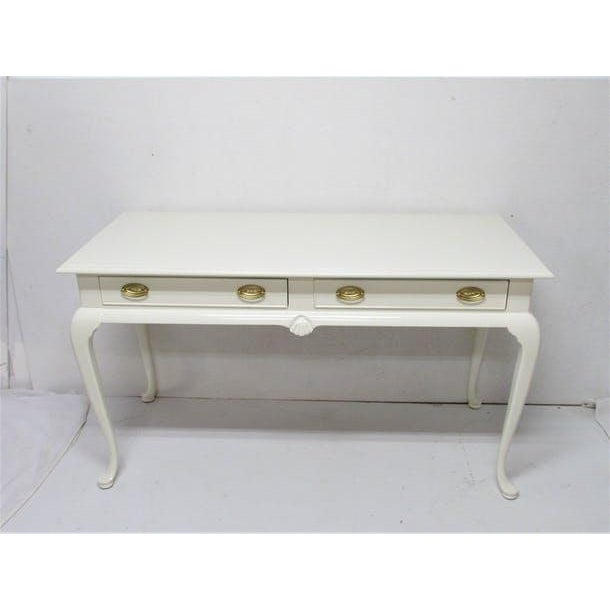 "Drexel desk with 2 dovetail drawers lacquered In-house in an alabaster high gloss finish. Dimensions 52.75"" L x 23"" W x 30"" H"
