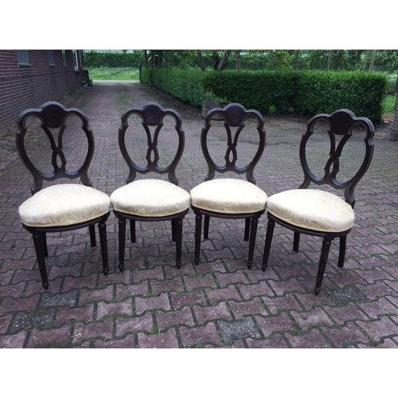 A set of 4 Louis XVI style French dining chairs, produced within the late 19th century period, seats upholstered with...