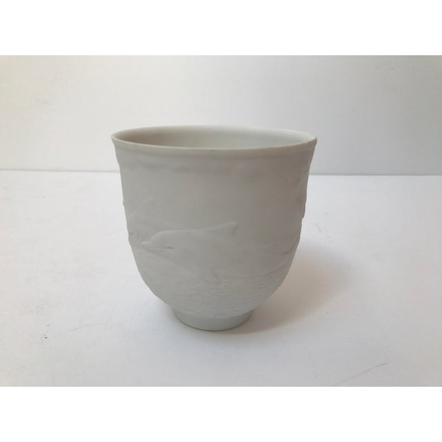 Matte white Lladro decorative porcelain cup. Made in Spain. Carved dolphins swimming in the sea carved on the sides. Good...