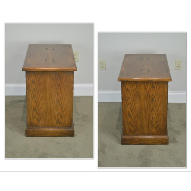 *STORE ITEM #: 19070 Romweber Viking Oak Bookcase 2 Drawer Side Table with Brass Inlaid Horseshoes AGE / ORIGIN: Approx....
