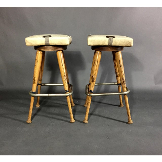 A pair of very well made bar height stools using Little League baseball bat legs and Home Plate seats. All bats are...