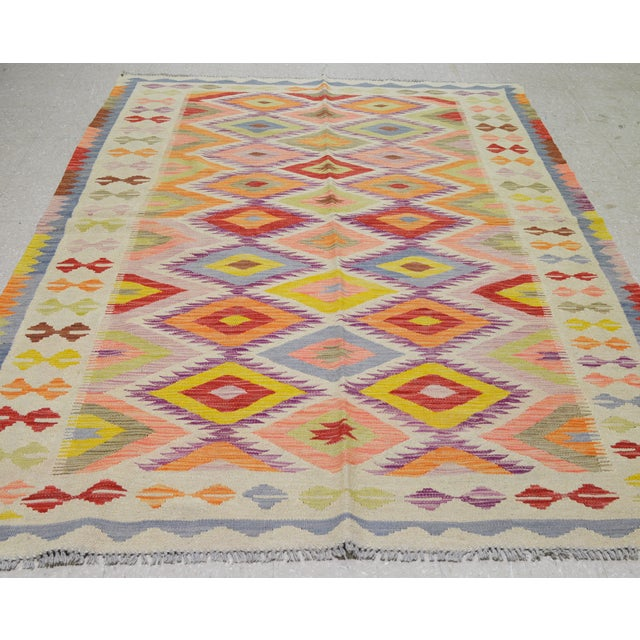 Vintage Afghan Maimana hand woven kilim with natural colors,organic wool and geometric pattern.