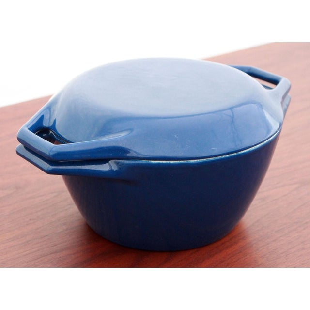 Vintage mid-century modern Copco cast iron with blue enamel dutch oven, designed by the renowned Danish designer, Michael...