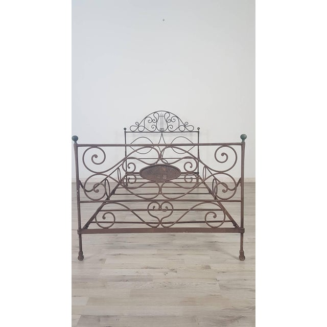 Antique bed made in full epoch Empire early 19th century in full wrought iron with refined processing of volutes and...