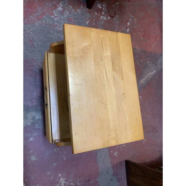 Solid and sturdy maple. Unusual curved concave drawer. One large drawer at the bottom with original brass tone pull. Open...