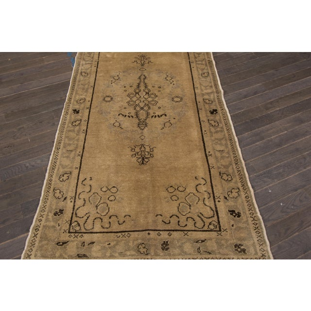 A hand-knotted vintage Khotan rug with a medallion floral design. This piece has great detailing and colors. It would be...