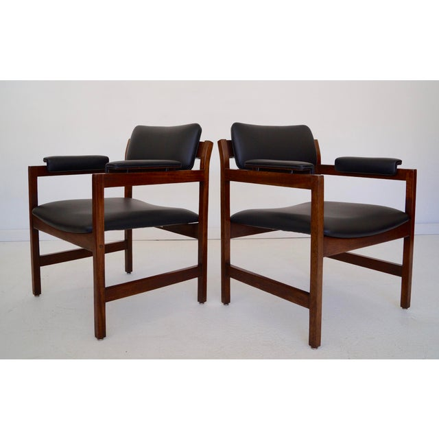 Super awesome pair of Mid-Century armchairs. They have high-quality frames made of solid walnut and have just been...
