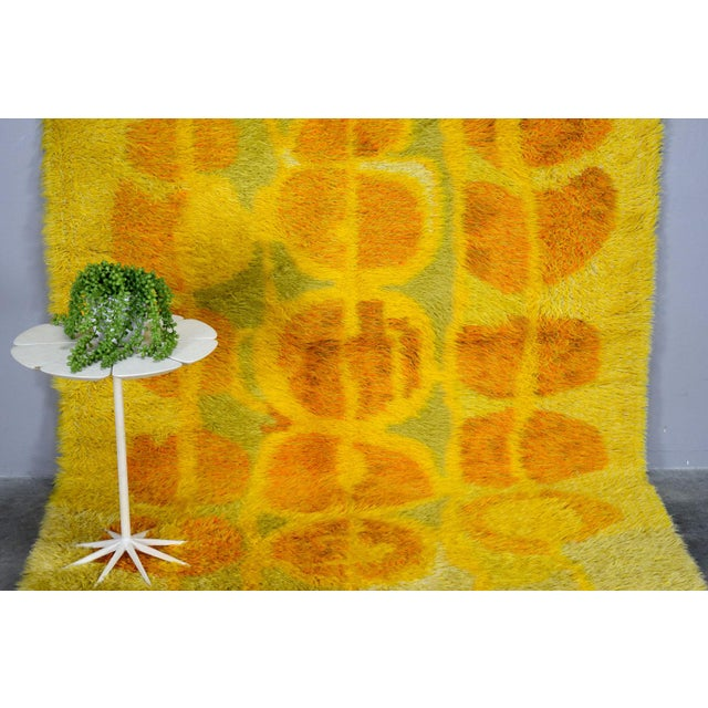 This is one of the most lovely rya rugs we've seen. Subtle organic design in warm yellows and soft green wool.