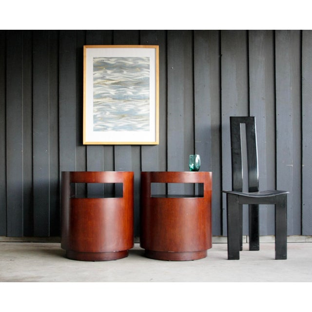 "Cylindrical nightstands by Crate & Barrel, each with a niche opening (each measures 4' H x 14.38"" W). Great form, shape,..."