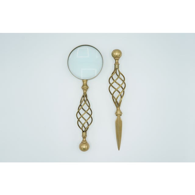 Vintage brass magnifying glass and letter opener set. Matching spiral handles. Fine condition, a unique pair for home or...