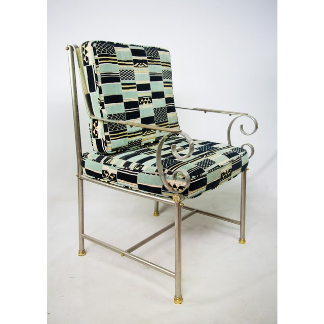 Mid-Century Modern elegant chrome armchair by Maison Jansen, featuring a navy blue, green, yellow and cream patchwork...
