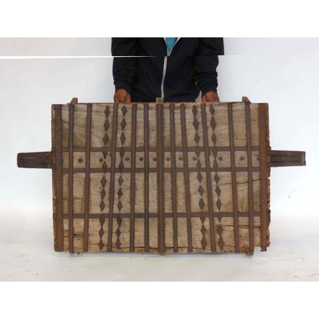 Old wood with decorative iron. Can be hung on wall either vertically or horizontally. Interesting iron work and pattern....