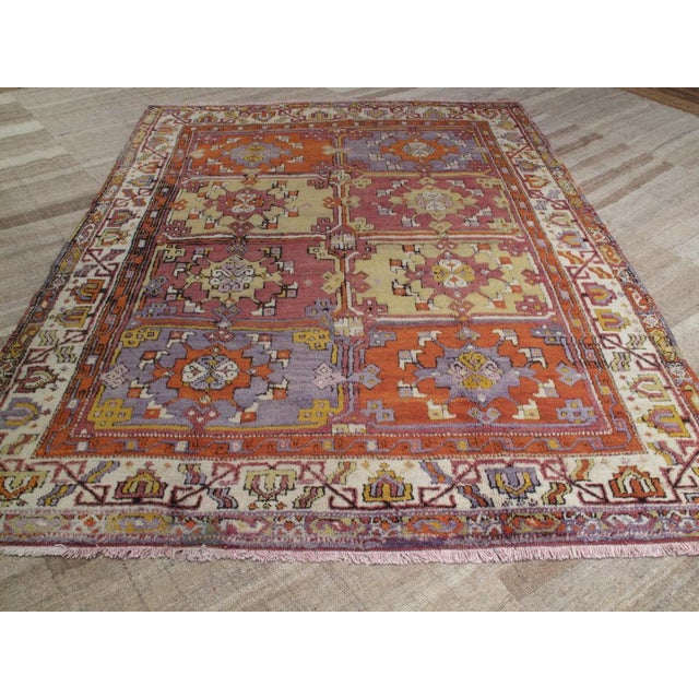 Lovely village carpet from Western Turkey featuring a classical design from this region. Great colors.