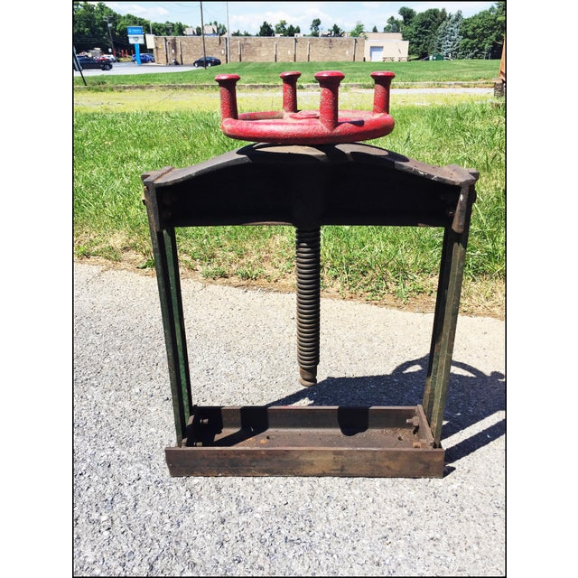 "VINTAGE CAST IRON CIDER PRESS. Nice industrial piece with original black paint. Original advertising reading ""Keystone..."
