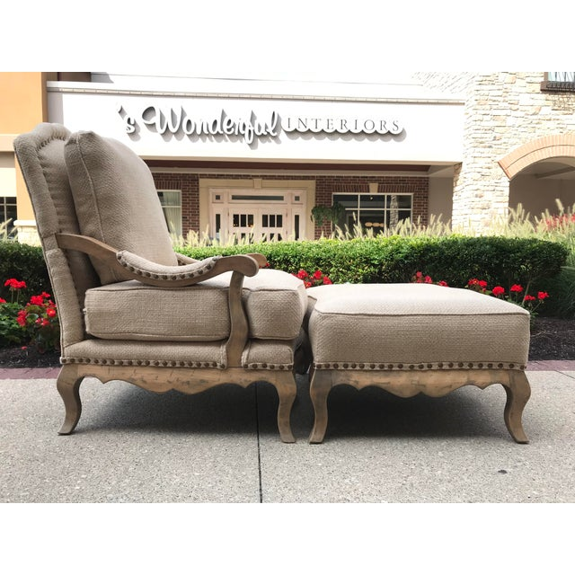 Beautiful Chair and Ottoman restored in a timeless woven linen/jute textile with accents of half inch aged brass nail...