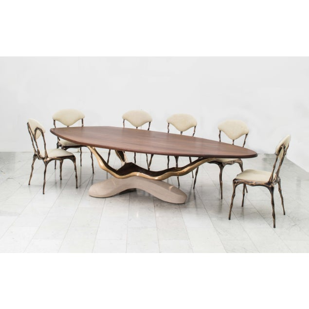 Markus Haase's one-of-a-kind 12-foot handcrafted dining table features a sculpted American black walnut top resting on a...
